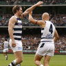 Gary Ablett celebrates a goal with Patrick Dangerfield.