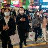 Pedestrians wear face masks in Hong Kong amid the coronavirus outbreak.