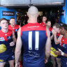 ERTH, AUSTRALIA - SEPTEMBER 25: Max Gawn of the Demons leads the team out onto the field during the 2021 Toyota AFL Grand Final match between the Melbourne Demons and the Western Bulldogs at Optus Stadium on September 25, 2021 in Perth, Australia. (Photo by Will Russell/AFL Photos via Getty Images)