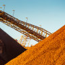 Surging iron ore price boosts BHP, Rio in 'championship quarter' for miners