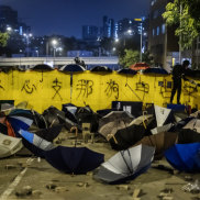 Umbrellas and barriers form a barricade on Junction Road during a protest outside the Hong Kong Baptist University in the Kowloon Tong area of Hong Kong, China, on Wednesday, Nov. 13, 2019. Hong Kong officials and Chinese state media warned of consequences if violence continued, as a third-straight day of protests disrupted traffic across the city and the government announced for the first time that it would close public schools. Photographer: Justin Chin/Bloomberg