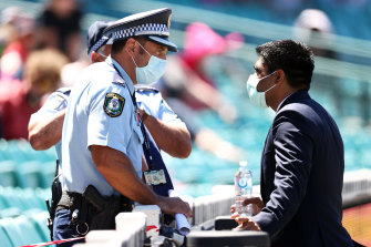 Police talk to a member of the Indian squad regarding a complaint by Mohammed Siraj of India during day four of the Third Test match in the series between Australia and India at Sydney Cricket Ground on January 10, 2021 in Sydney, Australia.