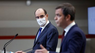 French Prime Minister Jean Castex, left, and French Health Minister Olivier Veran announce the extended national 12-hour curfew.