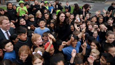 The Prime Minister surrounded by adoring fans in an Auckland schoolyard.