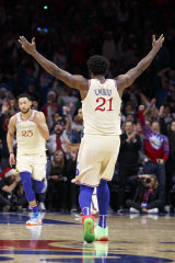 Embiid reacts to a Ben Simmons basket.
