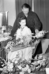 Sir Laurence Olivier and Vivien Leigh in Leigh's dressing room after the final curtain call on the opening night of School for Scandal at the Tivoli.