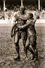 Norm Provan (St George) and Arthur Summons (Wests) leave a muddy SCG after the 1963 rugby league grand final.