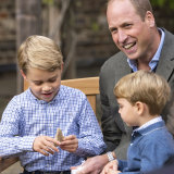 Prince William and Prince Louis react as Prince George holds the tooth of a giant shark given to him by Naturalist Sir David Attenborough.