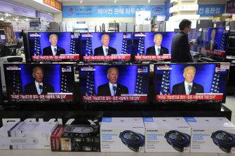 Screens in an electronics store in Seoul, South Korea show US President-elect Joe Biden speaking.