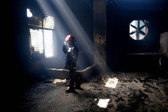 A firefighter inside the burnt food and beverage factory.