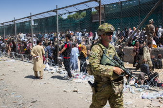 Australian soliders locating Afghan Australian visa holders attempting to enter the congested Abbey Gate at Hamid Karzai International Airport before the withdrawal.