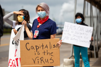 Demonstrators during a protest outside an Amazon.com facility in the Staten Island borough of New York earlier this month. Workers at Amazon and Walmart have threatened to walk off the job to protest their employers' failure to provide basic protections for employees who are risking their lives at work.