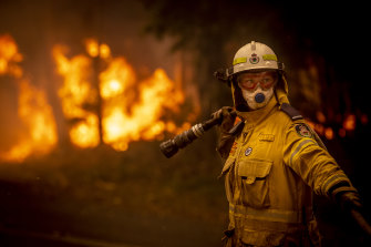 A Rural Fire Service volunteer works at Bawley Point.
