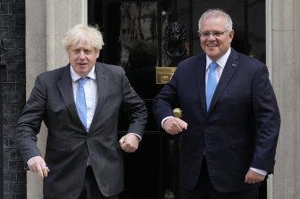 Britain's Prime Minister Boris Johnson greets Australia's Prime Minister Scott Morrison outside 10 Downing Street, in London.
