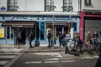 'Social distancing' outside a Paris bakery on Sunday. All shops, bars and restaurants  were closed. Only essential services, grocery stores and bakeries remained open for face-to-face customers. Fast-food outlets were closed, but were permitted to keep 'drive-thru' services open.