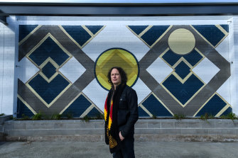 Artist Kent Morris in front of his new mural called 'Ancestral Connections – The Ties That Bind' in Brunswick.
