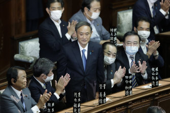 Yoshihide Suga receives a round of applause after being elected PM during an extraordinary session at the lower house of parliament in Tokyo on Wednesday.