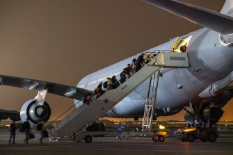 Afghanistan evacuees at Australia's main operating base in the Middle East board a Royal Australian Air Force KC-30 aircraft bound for Australia.