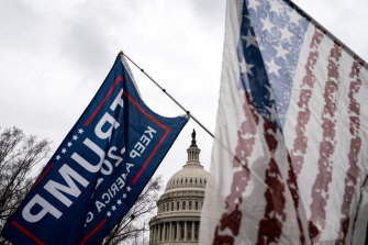 Supporters of President Donald Trump wave flags as they protest against the result of the presidential election in front of the Capitol in Washington on January 5.