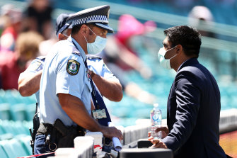 Police speak with a member of the Indian team staff on Sunday.