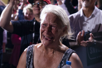 A supporter of President Donald Trump cries as he walks off stage after speaking at a campaign rally at Cecil Airport, Jacksonville, Florida.