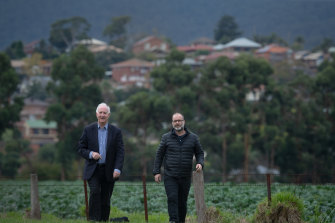 Farmland on Melbourne's city fringe has been central to how well Melbourne is coping during the coronavirus pandemic, academics Michael Buxton (L) and Andrew Butt say.