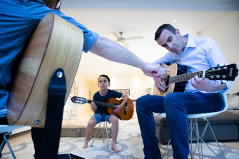 David Landau with his 7-year-old son, Ashton, took up guitar lessons during the COVID-19 pandemic.