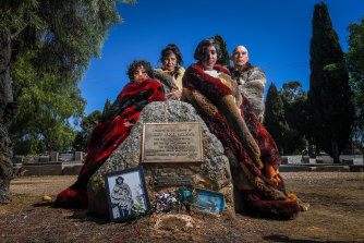 """Waywurru people (left to right) Shaniece Smith, Liz Thorpe, Jalina Smith and Thorn Smith at a memorial to Mary Jane Milewa in the Wangaratta Cemetery paid for by Fred Dowling and his family. The plaque identifies Milewa as """"the last member of the Pangerang tribe""""."""