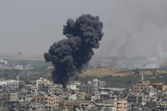 Smoke rises after an Israeli air strike in Gaza on Tuesday.
