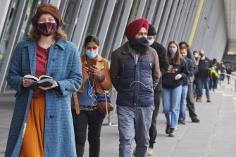 People waiting to get vaccinated at the Melbourne Convention Centre on Friday.