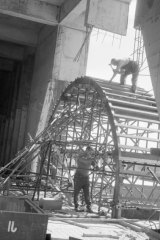 Workers rigging the scaffolding for the archway at the main entrance of the NGV, 1967.