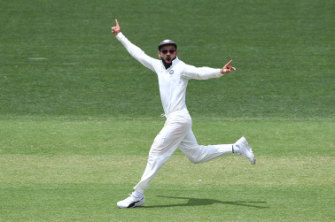 Kohli reacts to the dismissal of Usman Khawaja on day two of the first Test in Adelaide.
