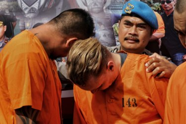 'We won't be lenient': Bali police parade Aussies in shackles after drug raids