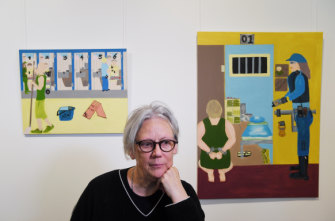 Art curator Elizabeth Day with some of the artwork created by inmates at Long Bay Correctional Complex.