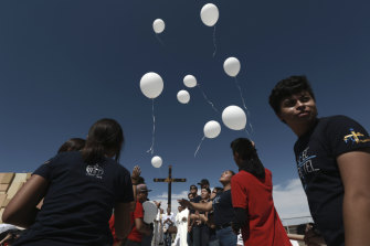 Mourners release balloons during a Mass for peace, in Ciudad Juarez, Mexico.