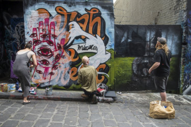 What is art? Artists Julia Both, Akemi and Junky Projects paint over a paid 'Just Married' mural by KIL Productions in Hosier Lane.