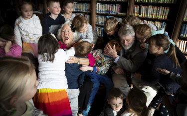 Residents Irene Axton and John Bower with children from the Little Diggers Preschool at the RSL Lifecare vets home.