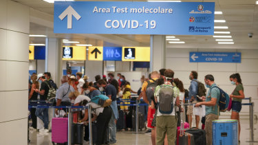 Travellers arrive at Rome's Leonardo da Vinci airport to be tested for the coronavirus as per a new rule imposed last week.