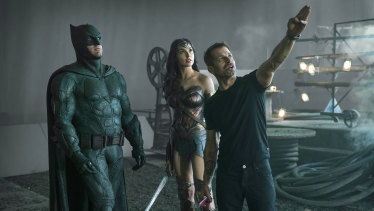 Snyder, right, with Ben Affleck as Batman and Gal Gadot as Wonder Woman on set.