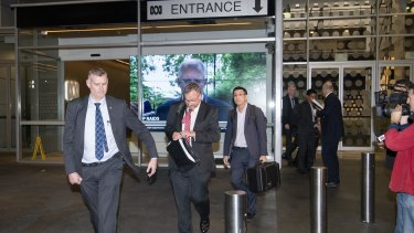 AFP officers leave the ABC Sydney building on June 5.