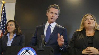 California Governor Gavin Newsom speaks to members of the press at a news conference in Sacramento on Thursday.