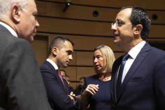 Italian Foreign Minister Luigi Di Maio (centre left) speaks with European Union foreign policy chief Federica Mogherini (centre right) in Luxembourg on Monday as some EU nations seek to extend trade restrictions against Turkey.