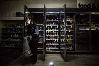CVS Pharmacy shift supervisor James Quinn throws out ice-cream from darkened freezers in downtown Sonoma, California.