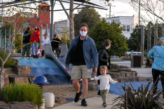 Kent Whalley and his son Heath at a busy Booran Reserve in Glen Huntly on Monday.