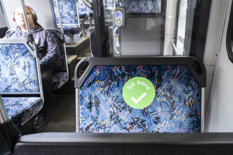 Stickers will indicate where people should sit on buses.