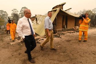 Prime Minister Scott Morrison and MP Darren Chester visit a farm in Sarsfield, Victoria.