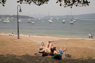 Enjoying the warm weather despite the smoke haze, at Watsons Bay,