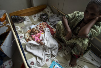 Birhan Etsana sits with her malnourished daughter Mebhrit, who at 17-months old weighs just 5.2 kilograms.