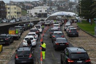 Cars queuing at the St Vincent's Hospital Bondi Beach Drive-through COVID-19 testing clinic.