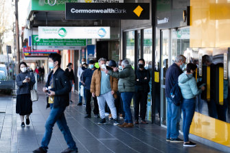 People line up outside the Commonealth bank in Campsie, a growing COVID-19 hotspot in the Bankstown Canterbury LGA.